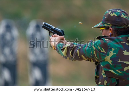 Shooting sports , female athletes ( Military) during shooting . The woman in the competition target shooting .   - stock photo