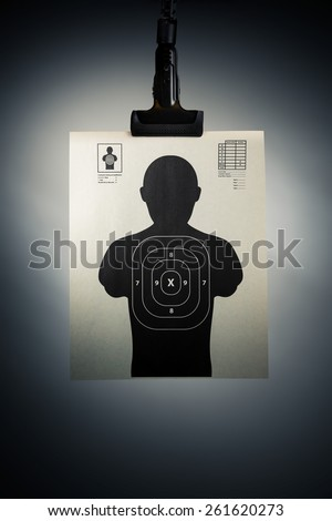 Shooting target hanging on a grey background - stock photo