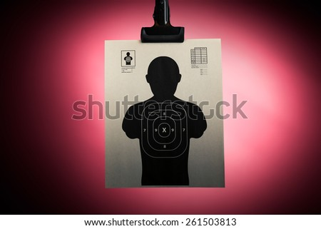 Shooting target hanging on a red background - stock photo