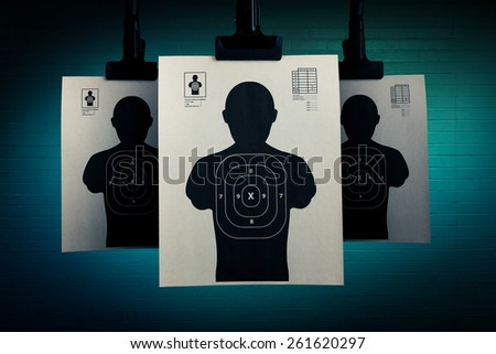 Shooting targets hanging on a grungy background - stock photo