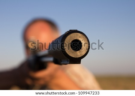 shooting with a gun on the nature - stock photo