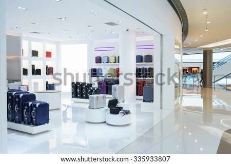 shop in empty hall, sell suitcases and bags - stock photo