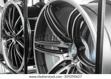 Shop shelves with automobile car alloy wheels. - stock photo