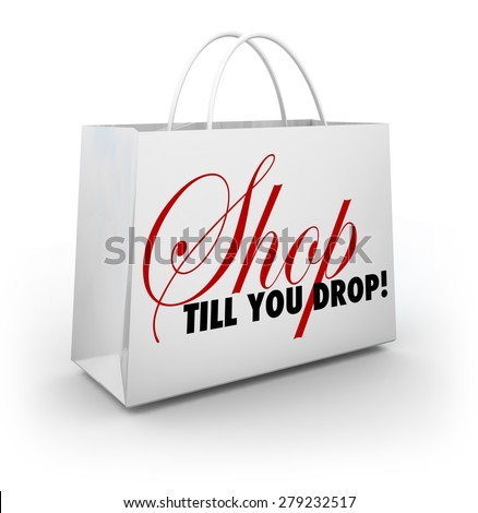 Shop Till You Drop words on a white shopping bag to illustrate discounts and sales to encourage you to spend more money - stock photo