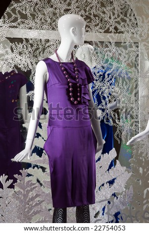 shop window with clothed mannequin - stock photo