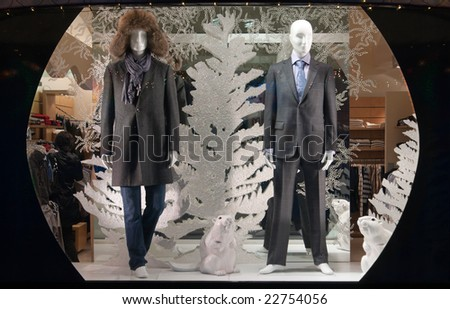 shop window with clothed mannequins - stock photo