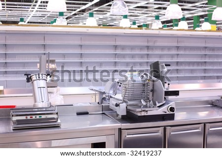 Shop with empty shelves and counters - stock photo