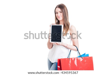 Shopaholic pretty girl holding modern tablet pc with blank screen as online shopping concept isolated on white with advertising area - stock photo