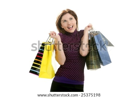 Shopaholic woman shopping with colorful bags isolated on white - stock photo