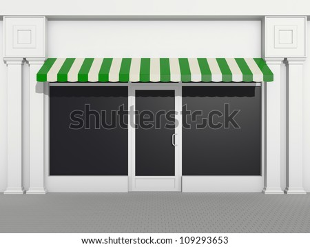 Shopfront - classic store front with green awnings - stock photo