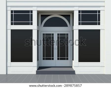 Shopfront with large windows. Classic White store facade. - stock photo