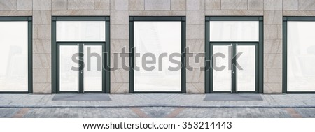 Shopfront with large windows. Showcase with Place for Name - stock photo