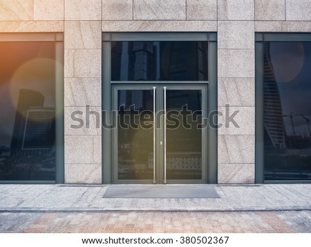 Shopfront with large windows with lens flare bokeh effect - stock photo