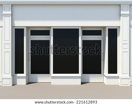 Shopfront with two doors and large windows. White store facade. - stock photo
