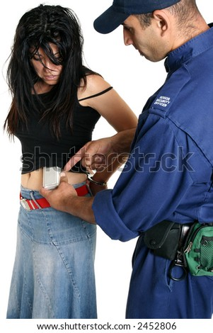 Shoplifting.   A security guard removes a concealed shoplifted item from a criminal - stock photo