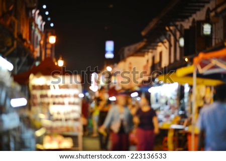 Shopper at Melaka Malaysia night market,purposely blurred. - stock photo