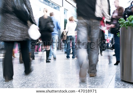 Shoppers at shopping center, motion blur - stock photo