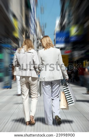 Shoppers in the street - stock photo