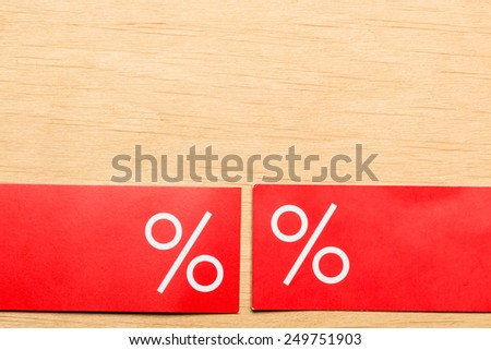 Shopping and sale concept. Red price labels with percent sign on wooden surface background. Copyspace - stock photo
