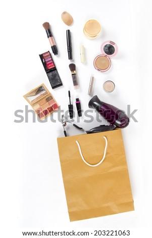 Shopping bag with cosmetics set, isolated on white background - stock photo