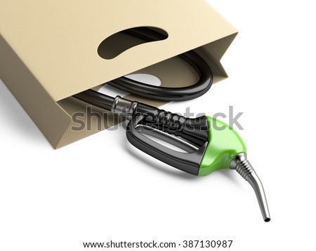 Shopping bag with green fuel pump nozzle. Bio fuel concept. - stock photo