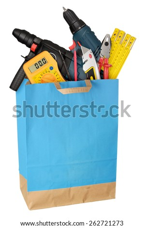Shopping bag with work tools isolated on white background. Full size - stock photo
