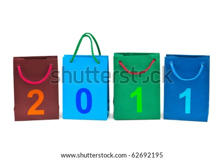 Shopping bags and numbers 2011 isolated on white background - stock photo