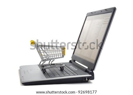 shopping basket on computer keyboard as symbol for online internet shopping - stock photo