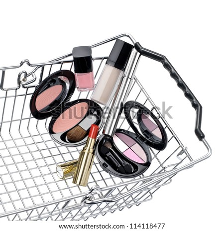 Shopping basket with a make up set - stock photo