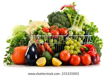 Shopping basket with assorted raw organic vegetables isolated on white - stock photo