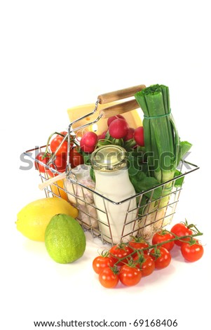 Shopping basket with milk, cheese and mixed vegetables - stock photo