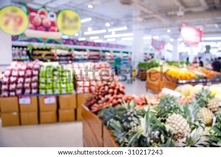 Shopping blur in the super market.The corridor filled with fruits, vegetables and other products. And products on the shelves in supermarkets. - stock photo