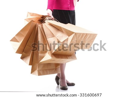 Shopping brown recycle gift bags in woman hand isolated white background - stock photo