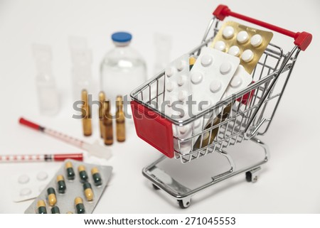 Shopping cart and medicine - stock photo