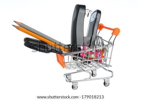Shopping cart and stationery within isolated on white background - stock photo