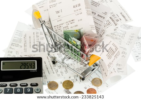 shopping cart, bills and receipts, symbol photo for purchasing power, consumption and inflation - stock photo
