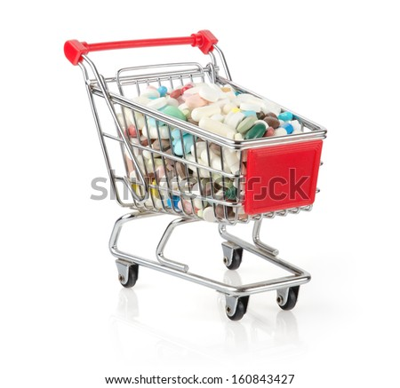Shopping Cart Filled with Capsules Isolated On White Background - stock photo