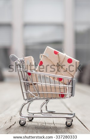 shopping cart filled with christmas gifts - stock photo