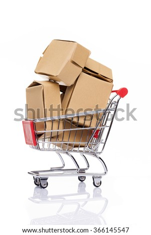 Shopping cart full of cardboard boxes, isolated on white background - stock photo