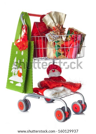 Shopping cart full of Christmas gifts on white background - stock photo