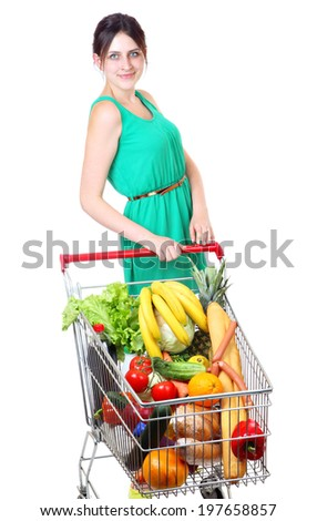 Shopping Cart Full Of Grocery, buying groceries in bulk, shoppers with shopping carts, supermarket trolley full of food, isolated on white background - stock photo