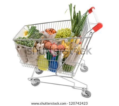 Shopping cart full of grocery isolated on white background - stock photo