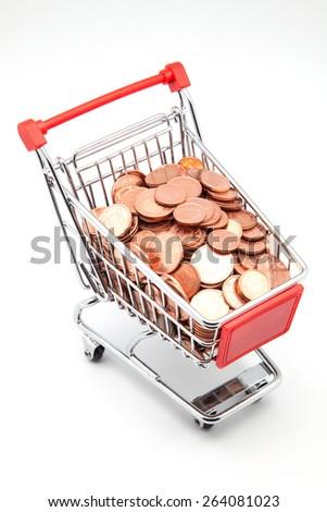 shopping cart full of money on white background - stock photo