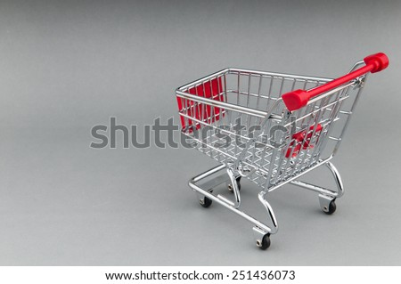 Shopping cart on seamless background - stock photo