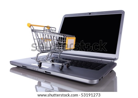shopping-cart over a laptop isolated on white with reflection - stock photo