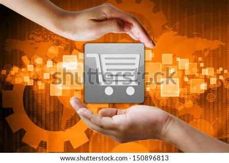 Shopping cart symbol on hand , Business background - stock photo