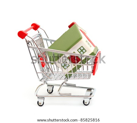 shopping cart trolley with house isolated on white - stock photo