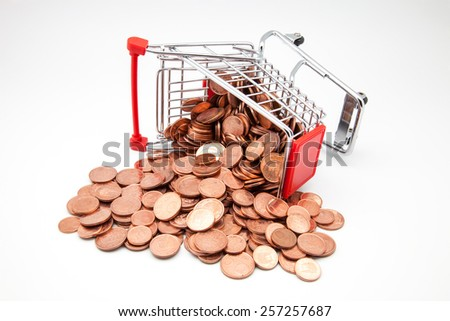 shopping cart with coins on a white background - stock photo