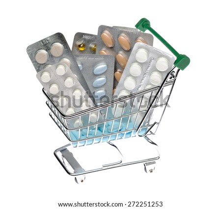Shopping cart with different pills blister pack on an isolated background - stock photo