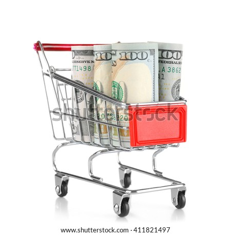Shopping cart with dollars inside isolated on white - stock photo
